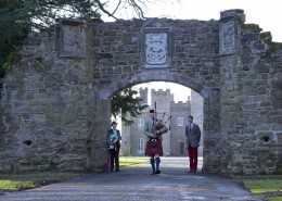 23.11.2012. Scone Palace Archway Restored. Former Scotts Guard and piper Malcolm Innes, who lives near the Palace, pipes through the restored Scone Palace arch which was officially re-opened by The Countess of Mansfield and her grandson William Murray Master of Scone. COPYRIGHT: Perthshire Picture Agency. Tel. 01738 623350 / 07775 852112.